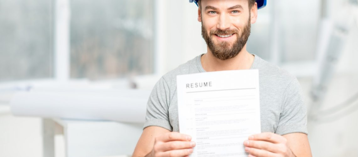 construction worker holding resume